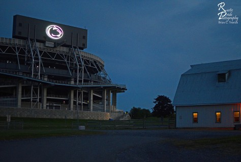 The new 35-foot by 25-foot Nittany LIon logo shines down on the Penn State horse barns. The new, 1,400 LED lights, were first lit on June 17, 2014, as part of a $10 million renovation of the Beaver Stadium score boards.