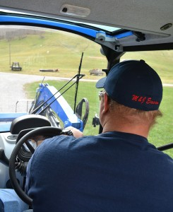Wesley Wright, drives his family's New Holland T4.75 on his family farm near Waynesburg, Pa.