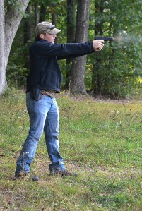 Dayne McKee fires his Glock 17 at a shooting range located near Julian, Pa. on Monday, September 22, 2014. McKee is a corrections officer at the Centre County Correctional Facility.